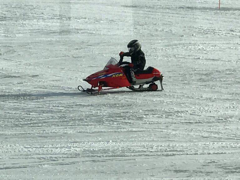 Kid Snowmobiling at Pats Landing